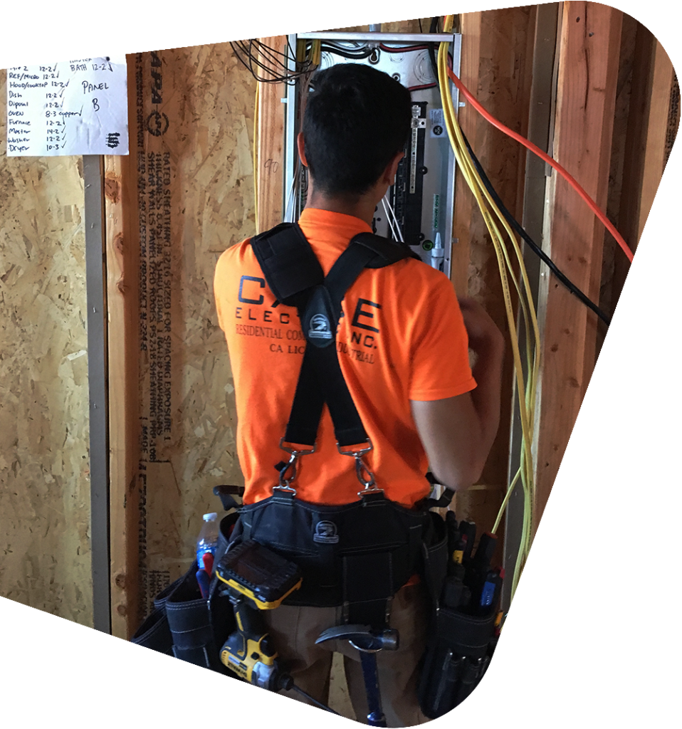 Electrician working on a panel for a commercial building.